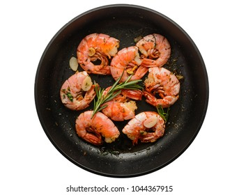 Pan of grilled prawn shrimps with garlic rosemary and spices isolated on white background, top view