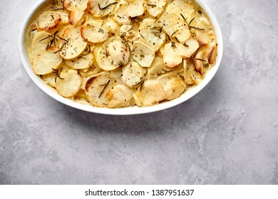 Pan haggerty or panackelty or Lancashire hotpot in deep dish overhead view with copy space
