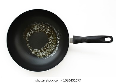 Pan with melted butter on white background