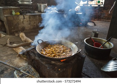 A pan on the fire in a typical Myanmar kitchen