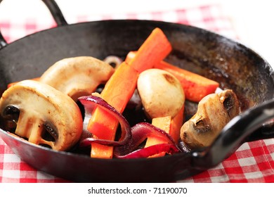 Pan roasted  mushrooms, and strips of carrot