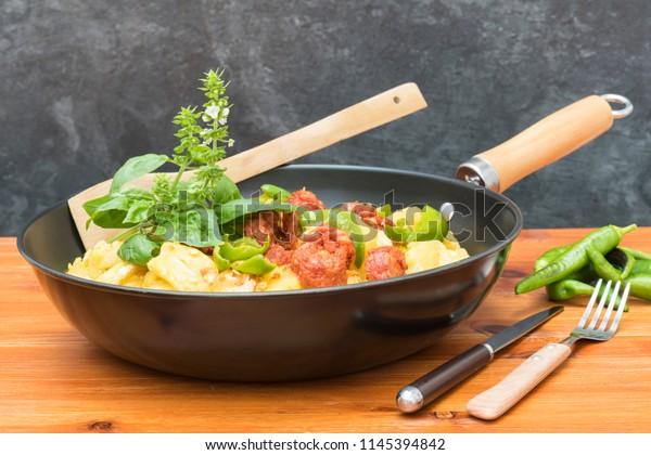 A pan of scrambled potatoes with egg and chorizo