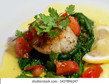 Pan Seared Sea Scallop on Spinach and tomato with Lemon Butter Sauce