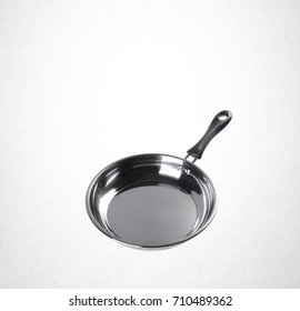 pan or stainless steel pan on background