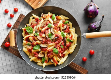 Beautiful Pan With Tasty Macaroni, Kitchen Board And Products On Grey Table, Top View