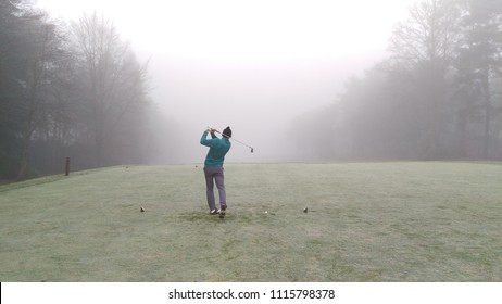 Pan teeing off during winter golf at foxhills