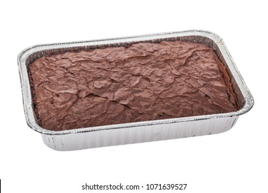 Pan of uncut fresh backed brownies isolated on a white background