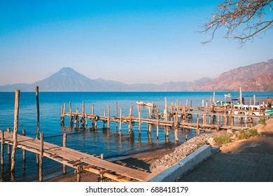 Panajachel, Guatemala -March 1, 2016: The docks in Panajachel with San Pedro volcano in the background. A few small boats are waiting for tourists in the morning for the Lake Atitlan tour in Guatemala