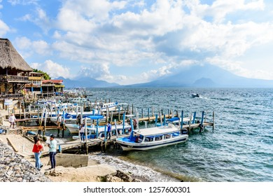 Panajachel, Lake Atitlan, Guatemala - November 12, 2018: Lakeside restaurants, jetties & boats with view of Toliman volcano & Atitlan volcano behind in Panajachel on Lake Atitlan.