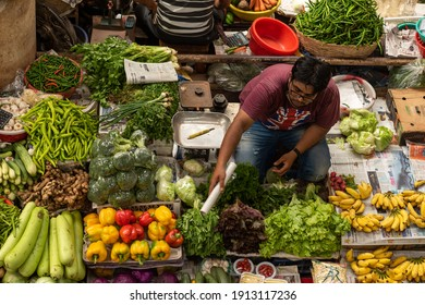 Panaji ,Goa India- Aug 2 2018: Indian fruit and vegetable vendors selling their product to locals in a local markets setup in India, Goa