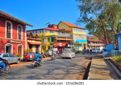 Panaji, India - January 23, 2019: Vehicles moving on the streets with colorful portuguese heritage buildings on the side.