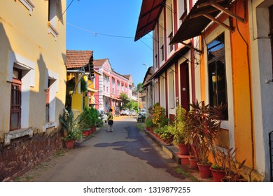 Panaji, India - January 23, 2019: A man standing in the road surrounded by colorful portuguese houses in Goa.