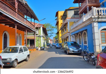 Panaji, India - January 23, 2019: Cars parked in streets surrounded by old portuguese buildings in Goa.