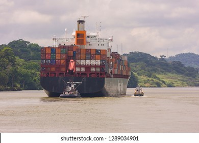 PANAMA - AUGUST 15, 2009: Hapag-Lloyd container ship and tugboat on Panama Canal.