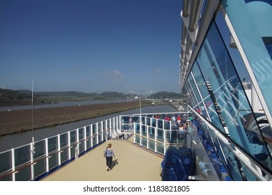 PANAMA CANAL - DEC 16, 2017 - Cruise ship passengers watch during a transit of the Panama Canal