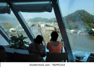 PANAMA CANAL - DEC 16, 2017 - Passengers watch the transit through the locks on a cruise ship in the Panama Canal