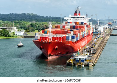 Panama Canal, Panama - February 20, 2015: Ship in Miraflores Locks Panama Canal, electric locomotives pull ships in transit through the locks  the Panama Canal