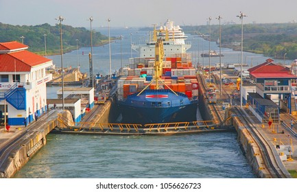 Panama Canal (Spanish: Canal de Panamá) is a 48-mile  ship canal in Panama that connects the Atlantic Ocean (via the Caribbean Sea) to the Pacific Ocean. Here, Freighter goes thru Canal. 3-2005.