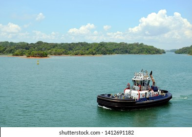 Panama Canal tugboat on her way to assist to a cargo ship during transit through the canal.