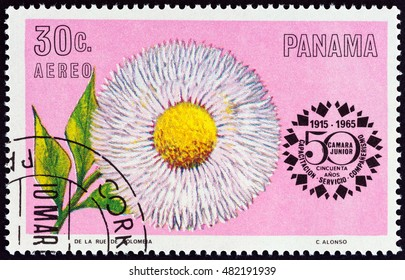"""PANAMA - CIRCA 1966: A stamp printed in Panama from the """"50th anniversary of Junior Chamber of Commerce - Flowers """" issue shows Double Daisy (Bellis perennis), circa 1966."""