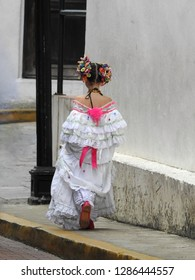 Panama City / Panama - 11 09 2018: Girl going to the first holy communion in traditional dress.