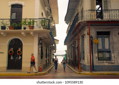 PANAMA CITY, PANAMA - APRIL 20, 2018: Unidentified people walking in a small alley in Casco Viejo a historical colonial center of Panama City. Cityscape - old town