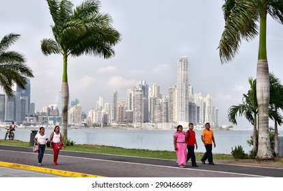 PANAMA CITY, PANAMA - APRIL 22, 2015: Afternoon Stroll on Panama City's Cinta Costera with City Skyline in the Background