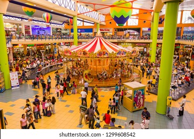 PANAMA CITY, PANAMA - AUGUST 21, 2009: People shopping at the Albrook Mall and Merry-go-round amusement.