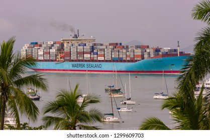PANAMA CITY, PANAMA - AUGUST 21, 2009: Container ship at Pacific entrance to Panama Canal passes by Balboa Yacht Club.