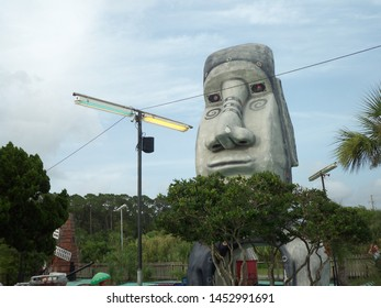 Panama City Beach, Florida / USA - July 13 2019: Easter Island head at Goofy Golf.