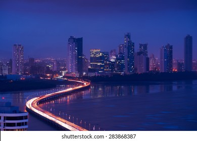 Panama City, Central America, view of Costa Del Este and Corredor Highway at night, with traffic jam of cars and vehicles