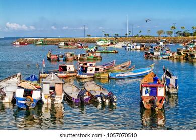 PANAMA CITY, PANAMA - FEB 27, 2018: Local fishing boats near sea food market in Panama City downtown.