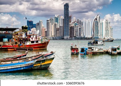 PANAMA CITY, PANAMA - FEB 27, 2018: Panoramic view of Panama City skyline on a sunny, clear day. Floating boats from a local fisher market in the foreground