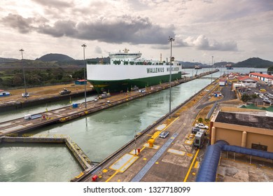 Panama City, Panama - February 2, 2019:  Wallenius Wilhelmsen, a large transatlantic cargo ship crossing from Atlantic to Pacific Ocean, entering Miraflores Locks in Panama Canal
