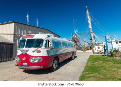 PANAMA CITY, FL - FEBRUARY 7, 2016: Vintage bus along the street in St Joseph Bay Aquatic Preserve. This is a famous attraction among tourists.