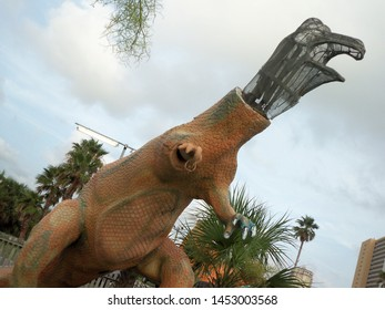 Panama City, Florida / USA - July 13 2019: Damaged Dino at Goofy Golf