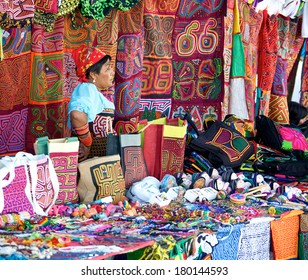 PANAMA CITY, PANAMA - JANUARY 18, 2014: A Kuna woman selling molas in an open air market in Panama City. The Kuna people, also known as Guna, are indigenous people of Panama and Colombia.