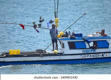 PANAMA CITY, PANAMA - MARCH 12, 2018: Three men on the boat in the Pacific ocean.