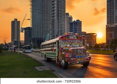 Panama City, Panama - March 18, 2014: A Red Devil bus in Panama City with modern building on the background at sunset, in Panama.