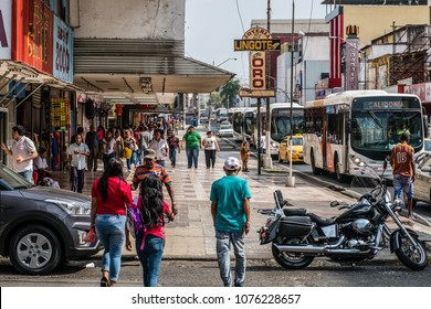 Panama City, Panama - march 2018: People and traffic on busy shopping street in Panama City, Avenida Central