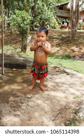 PANAMA, MAR 31: Embera tribal kid taking a shower outdoor dressed with their traditional custome in Panama on March 31, 2018.