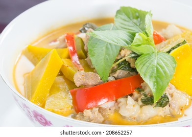 Panang Curry with pork Paste in coconut milk with sliced bamboo shoots, eggplant, bell pepper and basil leafs