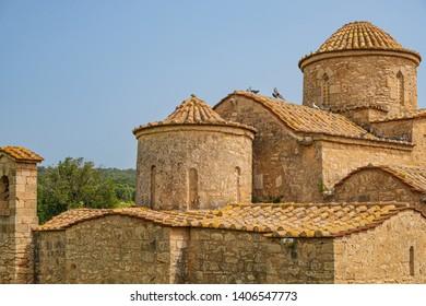 Panayia Kanakaria 6th century Byzantine Monastery Church originally containing Kanakaria mosaics in Lythrangomi, Island of Cyprus with pigeons flying off its roof