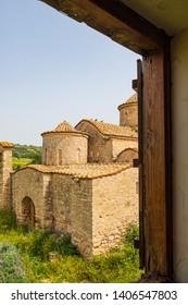 Panayia Kanakaria 6th century Byzantine Monastery Church originally containing Kanakaria mosaics in Lythrangomi, Cyprus viewd through a monastery window