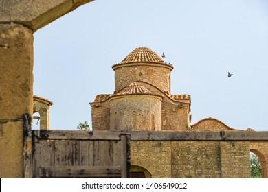 Panayia Kanakaria 6th century Byzantine Monastery Church originally containing Kanakaria mosaics in Lythrangomi, Island of Cyprus with pigeons flying off its dome