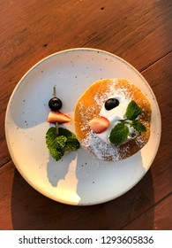 Pancake and berry fruit on dishes