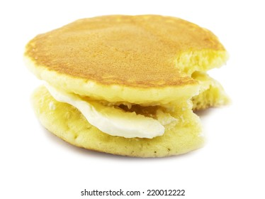 Pancake with a Bite Eaten on white background