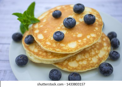 pancake and blueberries on a plate