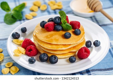 Pancake Blueberry Honey Dessert Stack Brunch. Fried Golden Sweet Crepe for Tasty Shrovetide Breakfast. Hotcake Syrop Product on Blue Tablecloth with Berry and Banana Mardi Gras Morning Lunch