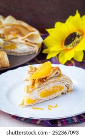 Pancake cake with oranges, whipped cream, delicious breakfast on Shrove Tuesday